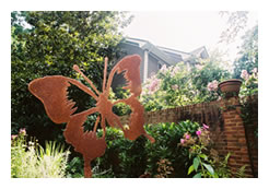 Butterly sculpture in garden of Inman Park Bed and Breakfast in Atlanta, Georgia